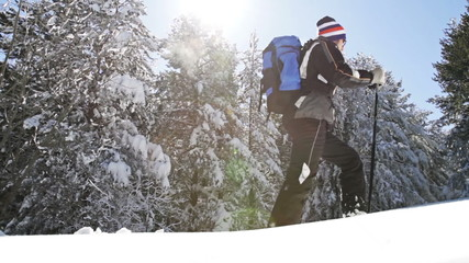 Backpacker Walking in the Mountains Snow Terrain Snowshoes