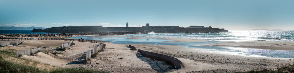 Breakwater in Tarifa beach. Andalusia, Spain