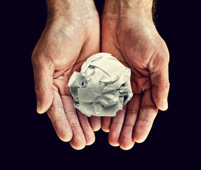 paper ball in hand