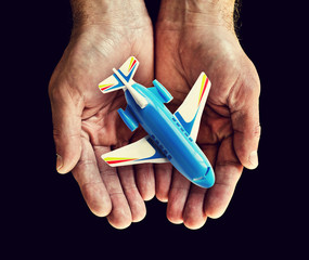 toy aircraft in hands