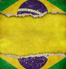 Torn cardboard or old teared paper grunge Brazil flag
