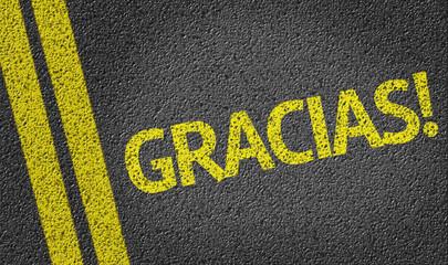 Gracias written on the road