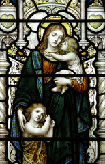 Mother with children in stained glass