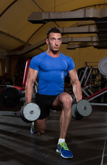 Man Doing Dumbbell Lunges