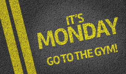 It's Monday Go to the Gym written on the road