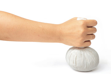 Hand with spa herbal balls