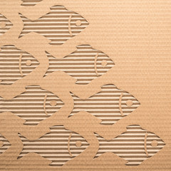 Fishes cut out on a corrugated cardboard