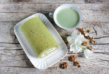 Matcha green tea swiss roll with whipped cream with walnuts