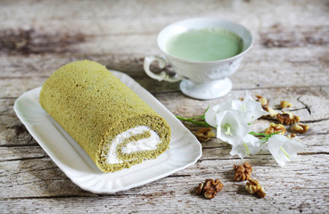 Matcha swiss roll roly poly whipped cream and walnuts, green tea