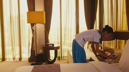 3of5 Asian housemaid cleaning hotel room, woman at work, job