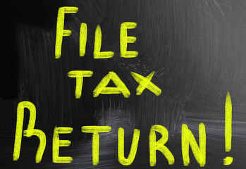 file tax return handwritten with chalk on a blackboard