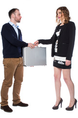 Woman handing suitcase to a man