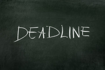 "Word ""Deadline"" writed on blackboard with chalk"