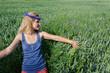 girl cornflower crown on head resting in meadow