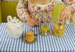 girl hand prepare marigold herb tea
