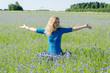 woman enjoying nature in harmony cornflower meadow