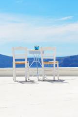 The chairs on the top of house, Santorini island, Greece