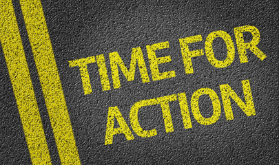 Time for Action written on the road