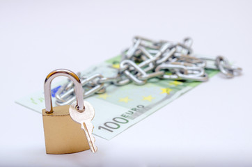 euro bill with padlock and chain