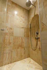 Modern shower cabin in hotel bathroom