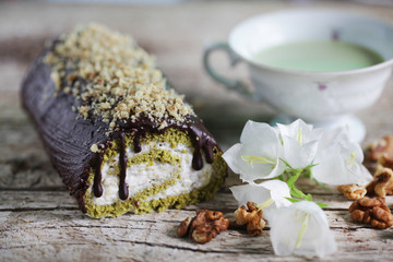 Chocolate covered matcha mint swiss roll with cream and walnuts