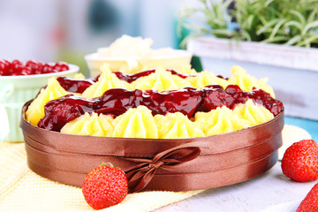 Tasty fruity homemade pie with berries, on table