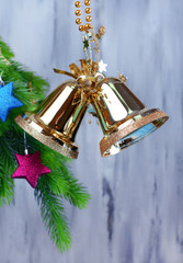 Bells with Christmas decoration on wooden background