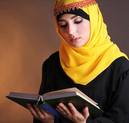 Beautiful muslim arabic woman reading book