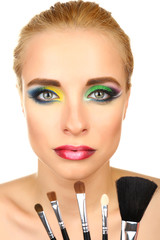 Beautiful woman with bright make-up and brushes, isolated