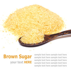 Organic brown sugar and wooden spoon isolated on white backgroun