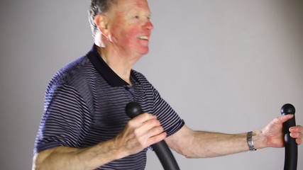 Senior man exercising in a fitness