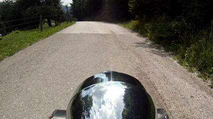 Riding with a motorcycle on a winding mountain road