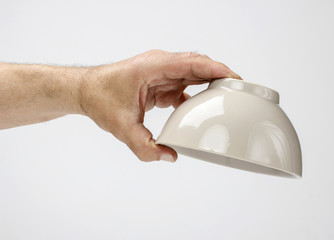 Hungry man holding empty bowl