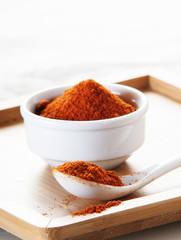Paprika spice on wooden background close up