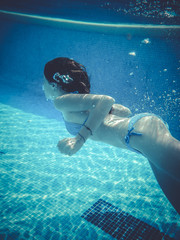 teenager diving into a pool