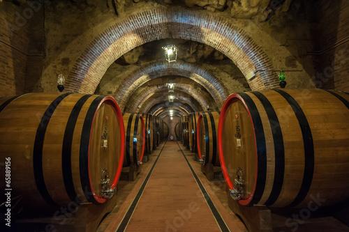 Fototapeta Wine barrels (botti) in a Montepulciano cellar, Tuscany