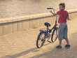 Boy with his bicycle. Young boy riding bicycle on a summer day