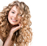 Beauty girl with blonde curly hair.  Long permed hair poster