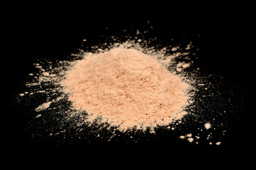 Loose Face Powder on Black Background