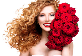 Beauty woman with long permed red hair and beautiful red roses