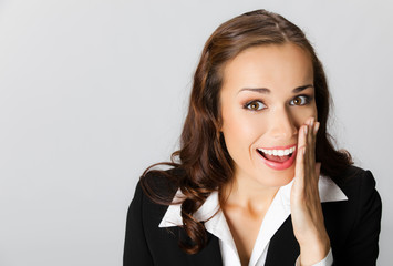Businesswoman covering mouth, over grey