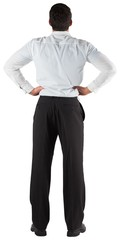Businessman standing back to the camera with hands on hips