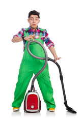 Funny man in green coveralls vacuum cleaning