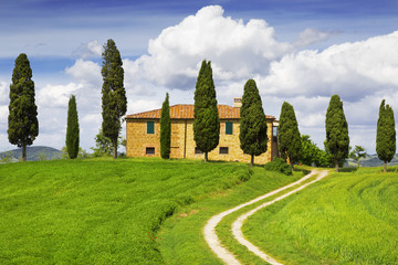 Rural house with cypress trees around, Tuscany, Italy