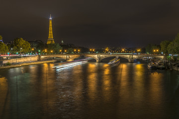 Long exposure of boats traffic in the Seine at night