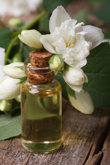 fragrant oil of jasmine flowers macro vertical
