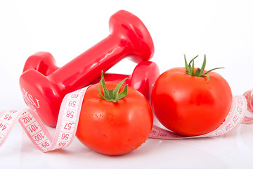 Two of dumbbells Isolated with  measuring tape and tomato