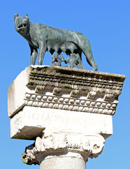 Ancient Capitoline Wolf above the Roman column while suckling Ro