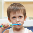 Little boy brushing his teeth