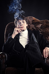 young successful businessman smoking a cigar